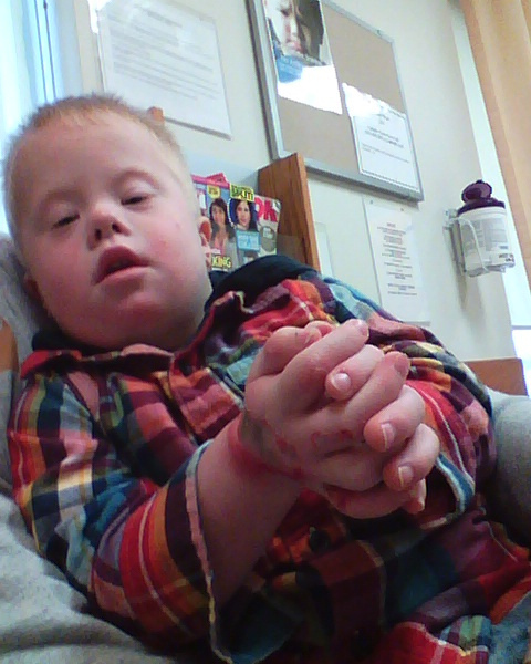 Treyton was careful about how he held his hands at the urgent care doctor.