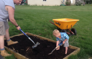 Treyton helping in the garden.